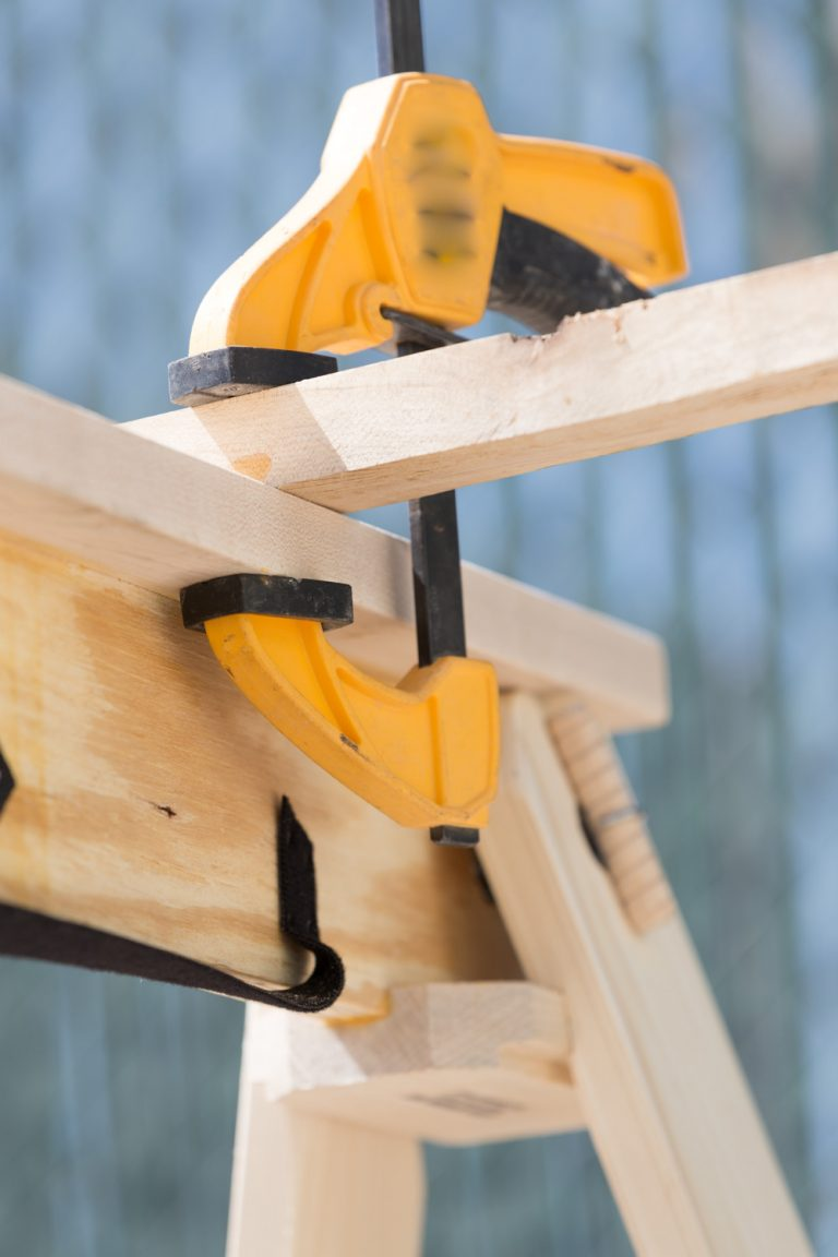 folding sawhorse with clamp attached