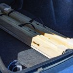 Pair of foldable sawhorses stored in trunk